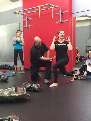 instructor helping people exercise