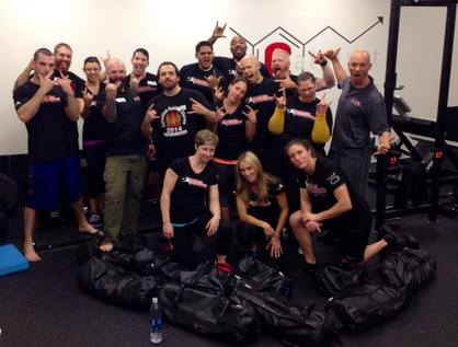 group of people posing with their ultimate sandbags