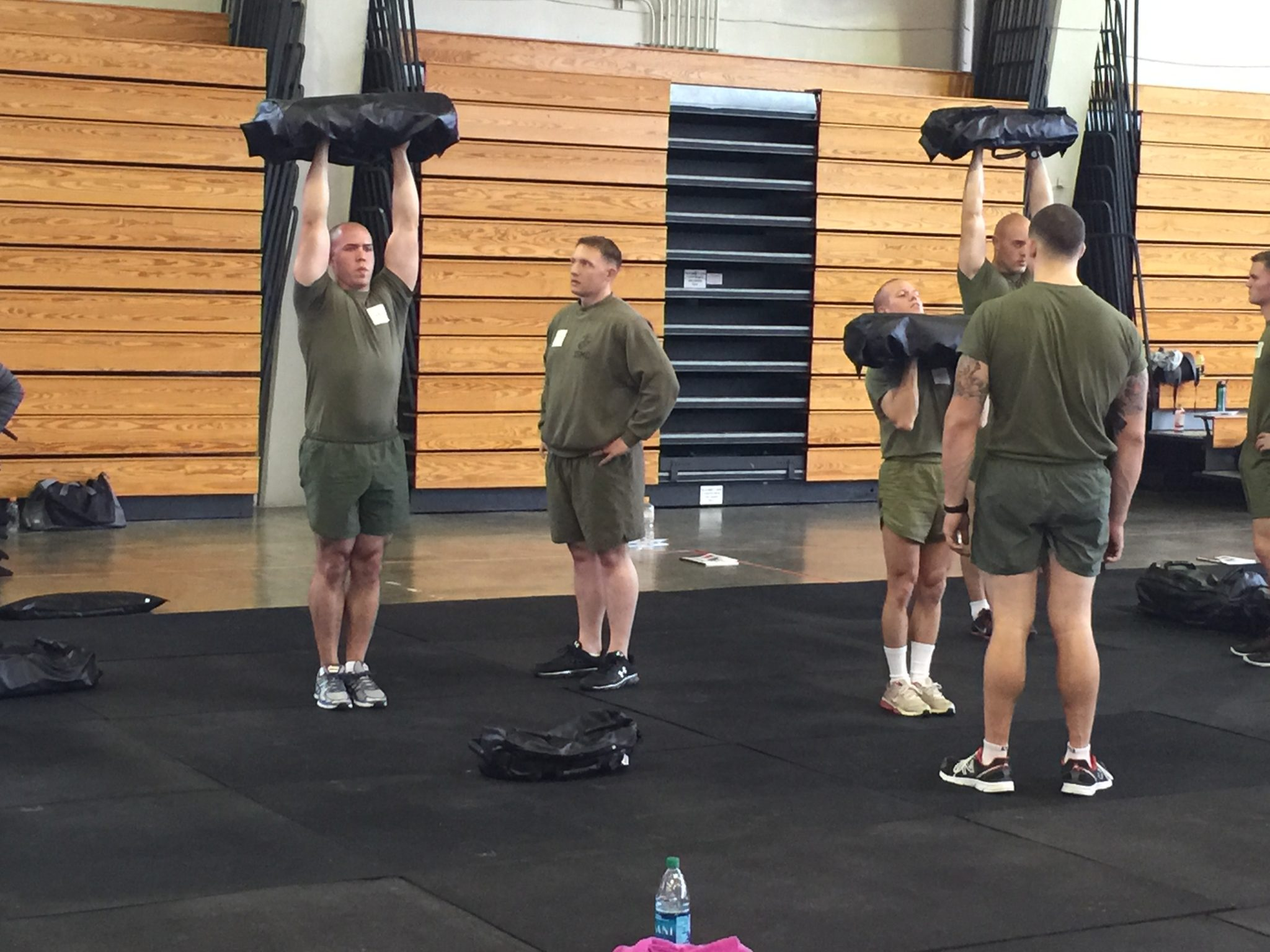 Four men giving Ultimate Sandbag Training reviews