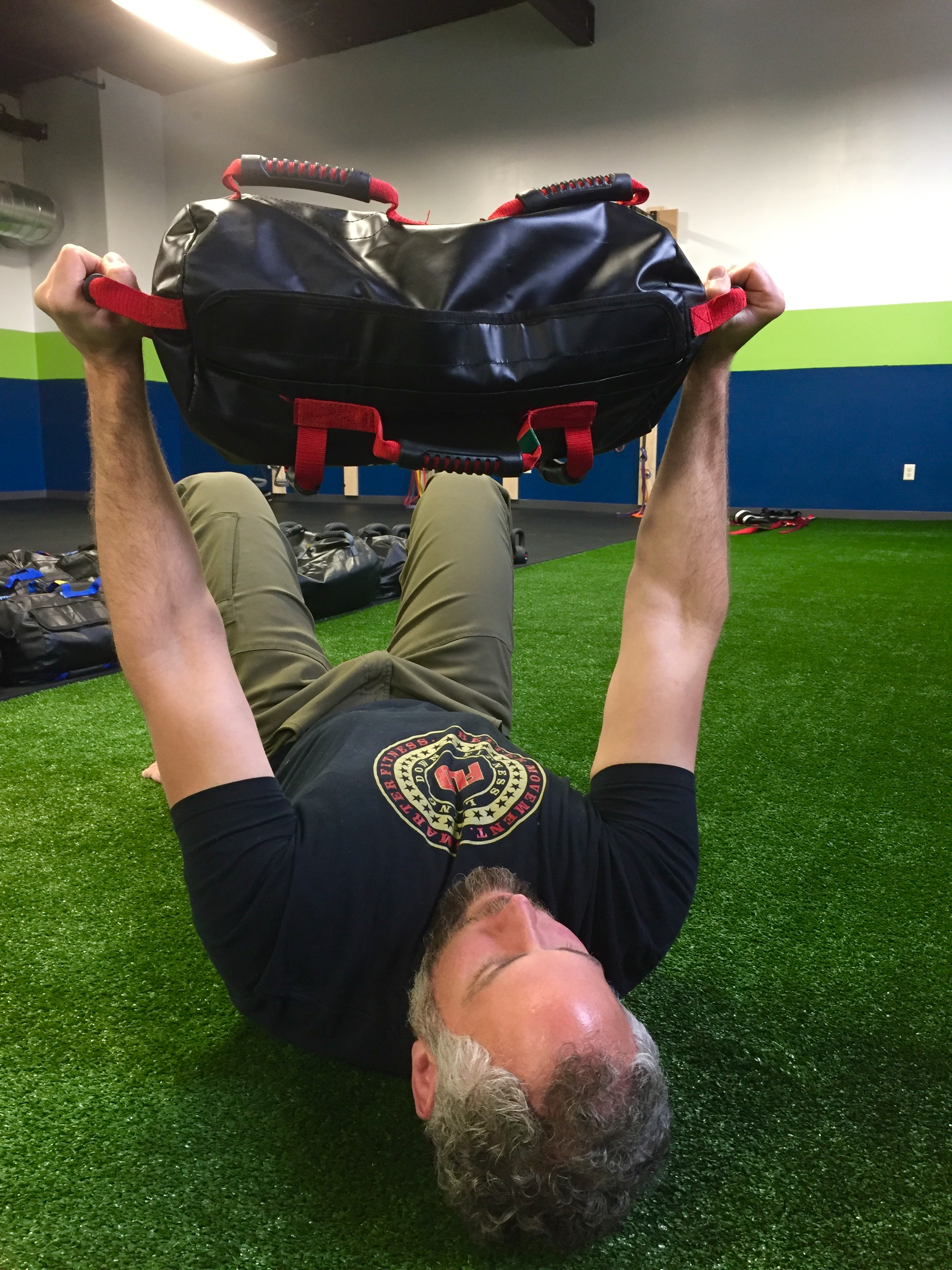 sandbag glute bridge