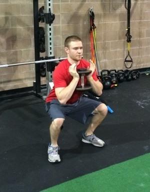 Goblet squat finish - Smarter Keys to Optimizing Goblet Squats